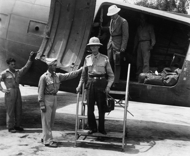 On August 28, 1945, General Jonathan Wainwright steps down from a C-47 transport in Chunking, China, after three arduous years in a Japanese prison camp.