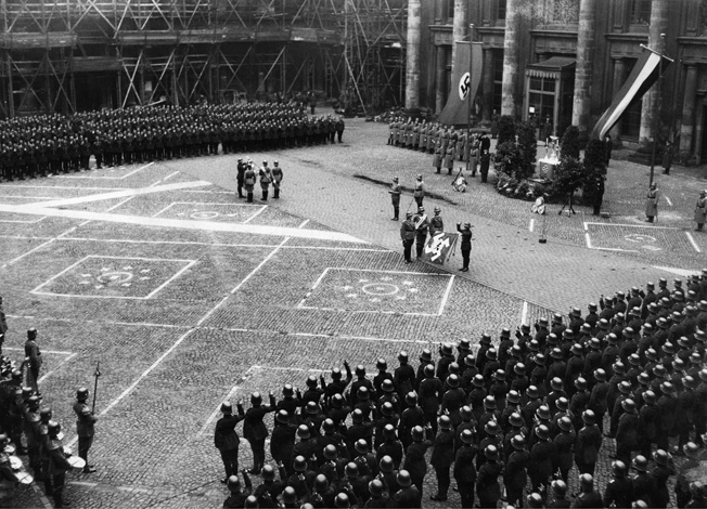 GERMANY: POLICE, 1934. Swearing in of 800 new police officers in the Schlueter courtyard of the Berlin Stadtschloss. Photograph by Paul Mai, November 1934.