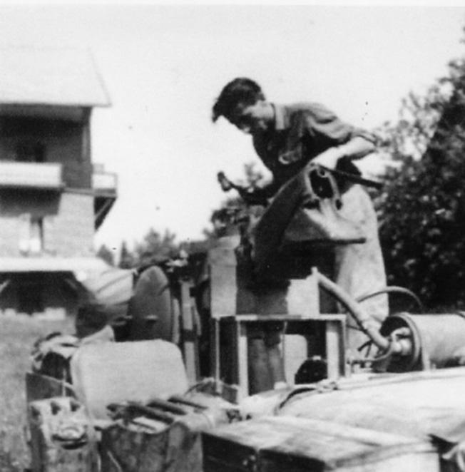 One of Popski's lieutenants, Nick Hubbard, mounts a flamethrower atop a PPA jeep.