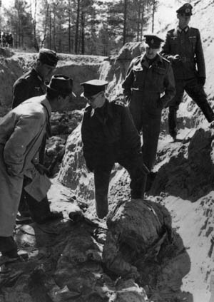 German investigators examine a mass grave in the Katyn Forest. Shortly after the discovery of the graves in 1943, the German government broadcast the news to the world. Soviet Officials denied any involvement.