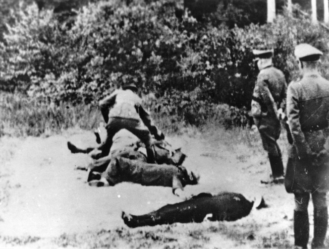 HOSTAGE EXECUTION, 1942. Execution of hostages by members of the German secret police at Luby, in the German protectorate of Bohemia and Moravia, 27 May 1942, perhaps as punishment for their suspected involvement in the assassination of Reinhard Heydrich.
