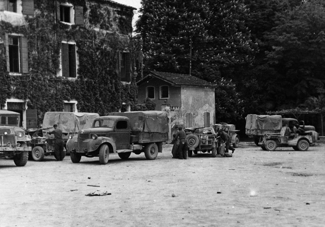 PPA vehicles are shown during a 48-hour rest and refit period on the campus of the University of Padua, Italy, in the spring of 1945.