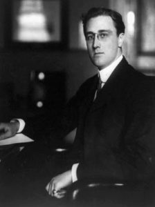 In this 1913 photograph, future President Franklin D. Roosevelt poses while holding office of Assistant Secretary of the Navy. (National Archives)