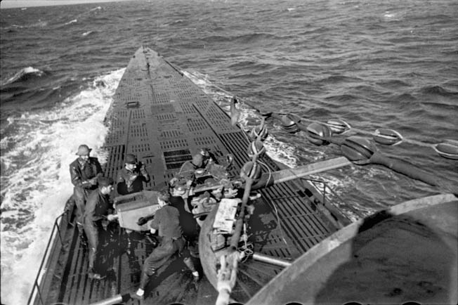 Reinhard Hardegan was one of several German U-boat commanders who terrorized the U.S. East Coast during Operation Drumbeat. In this photo crewmen of Hardegan's U-123 engage the British freighter Culebra with their deck gun on January 25, 1941. The Culebra was sunk by the Germans, and the vessel's crew was offloaded into lifeboats and given the proper course for Bermuda.