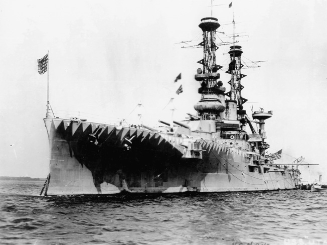Converted to a target ship in 1930 , the battleship USS Utah is shown during World War I in a camouflage scheme intended to confuse the enemy range finders.