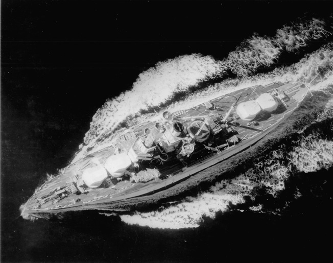Plowing through the Pacific on December 10, 1936, the USS Utah is employed as a target ship by the navy. Her 12-inch main guns and other weaponry have been removed.