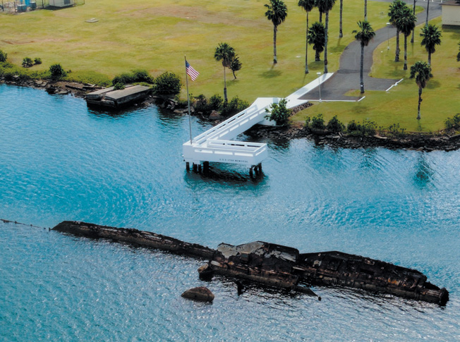Overshadowed by the stately memorial to the USS Arizona less than a mile away, the simple memorial constructed at the grave of the USS Utah in 1972 commemorates the 54 sailors who lost their lives aboard the vessel on December 7, 1941.