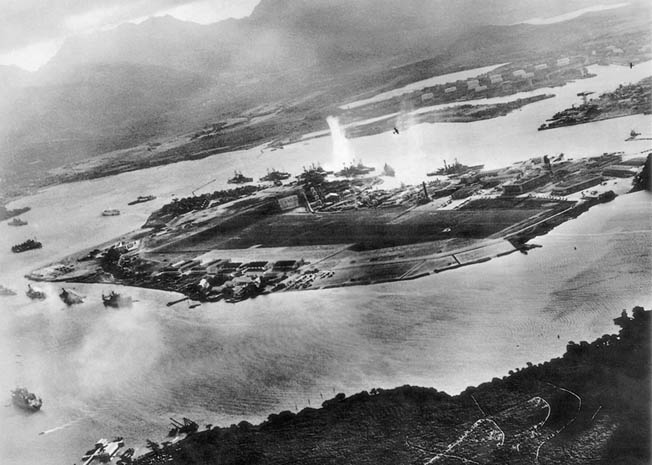 Early in the attack, a Japanese aviator captured this view of Pearl Harbor just as an explosion took place between Oklahoma and West Virginia. Visible are two Japanese planes.