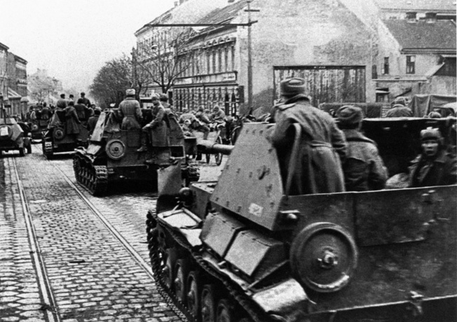 The might of the Red Army prevailed in the battle for Vienna in the spring of 1945. Soviet soldiers and their supporting self-propelled assault guns maneuver through the suburbs of the Austrian capital city in April.