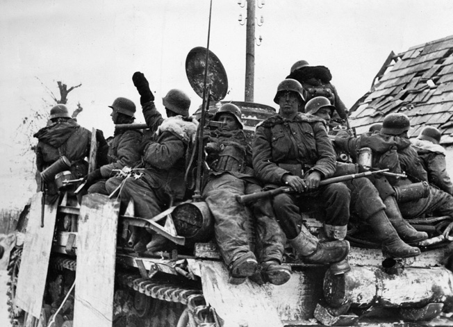 Despite the more famous Tiger and Panther models, the armored workhorse of the German Army in World War II was the ubiquitous Panzer IV medium tank. Here, battle-weary Waffen SS soldiers ride atop a Panzer IV during the long retreat to the Fatherland in January 1945.