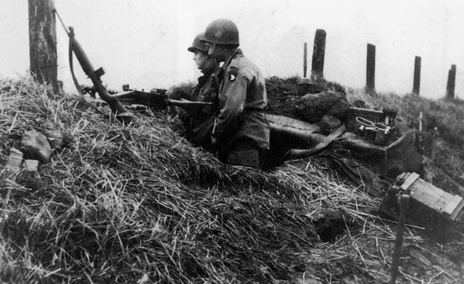 "Operation Market Garden ended in a strategic defeat for the Allies attempting to strike the German industrial heartland, the Ruhr, through Holland. Here, a pair of 101st Airborne soldiers mans a defensive position at the ""Island"" in the division's zone of operation."