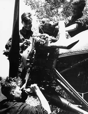 Working on the engine of a U-2 biplane, a trio of female mechanics prepares this Red Air Force relic for a nightly harassment mission against the invading Germans.