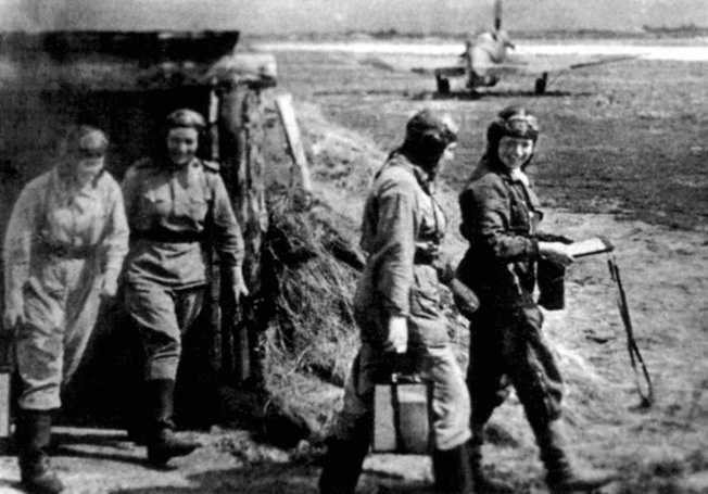 After a pre-mission briefing, members of the 586th Regiment head for their aircraft and another confrontation with the Luftwaffe in the skies above the Eastern Front.