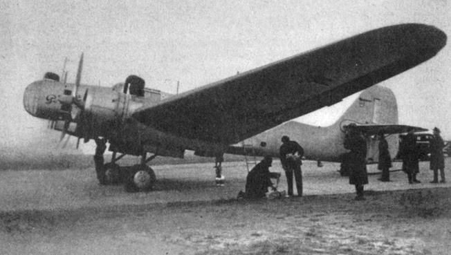 The Rodina is checked out by mechanics some time before its celebrated flight to the Manchurian border.