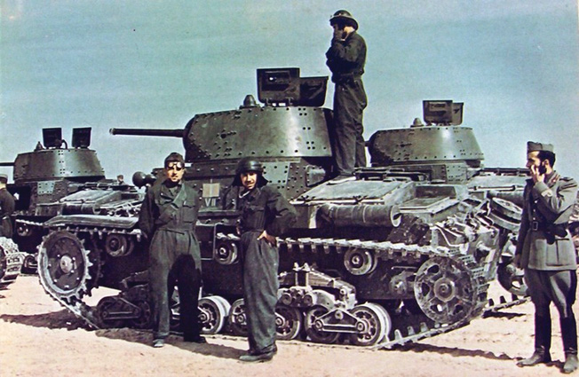 Photographed in March 1941, these Italian tank soldiers have paused with their M13/40 light tanks to survey the terrain ahead. The Italians performed well at Bir el Gubi as the British attempted to relieve the embattled Tobruk.