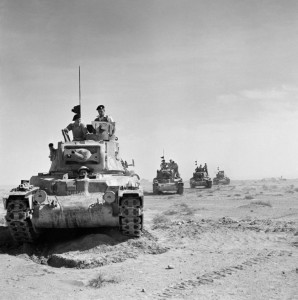 On November 18, 1940, the day before the battle at Bir el Gubi, British Matilda tanks roll forward during the opening phase of Operation Crusader. The British armor spearheaded an effort to reach the Australian garrison besieged at the Libyan port of Tobruk.
