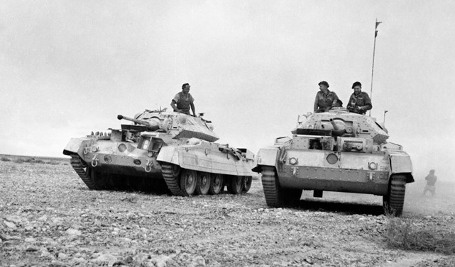 A pair of British Crusader tanks takes up positions in the forefront of their formation as the two commanders confer during Operation Crusader. At the time of the action at Bir el Gubi, the Crusader was the frontline tank of the British armored units in North Africa.