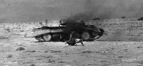 WORLD WAR II: NORTH AFRICA. A burning British tank after being hit during the army's Operation Crusader outside of Tobruk, Libya. One crew member is escaping. Photograph, August 1941. Full credit: Eric Borchert - ullstein bild / The Granger Collection.
