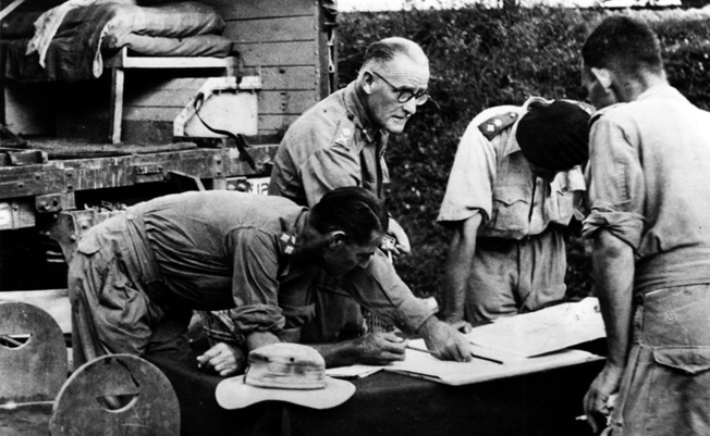 Major General D.T. Cowen (center) of the 17th Indian Division briefs subordinates on the plans for coming engagement.