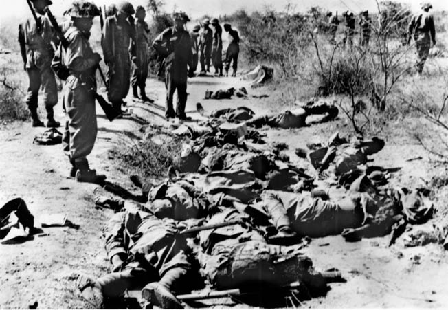 Japanese dead fill a ditch after an unsuccessful counterattack at Meiktila, March 1945.