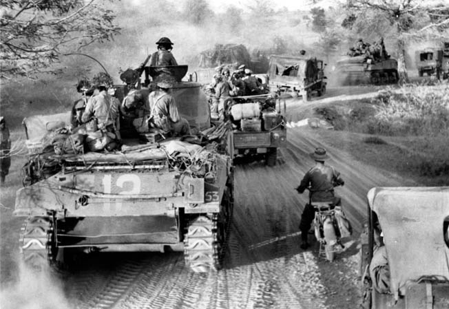 A British convoy from the 63rd Motorised Brigade advances from Myingyan toward Meiktila, March 1945. RIGHT: Maj. Gen. David T. Cowan, commanding the 17th Indian Division, confers with some of his officers. The British recapture of Burma saved India from Japanese invasion.