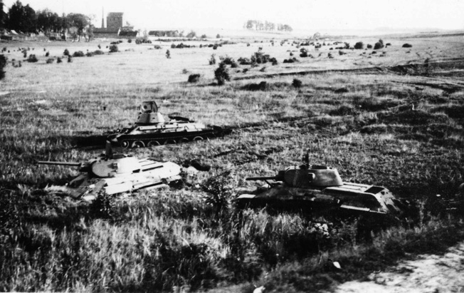 A group of Russian tanks lies mired in the mud of the Russian steppes at Tolotschin.
