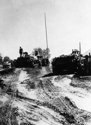 In July 1941, German tanks assemble for the crossing of the Dniepr River. The summer rains had begun to turn dirt roads into quagmires, slowing the German advance.