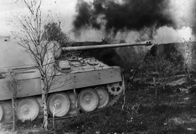 A Panzer V Panther of the Panzergrenadier Division Grossdeutschland rolls into action during Operation Bagration, June 1944.