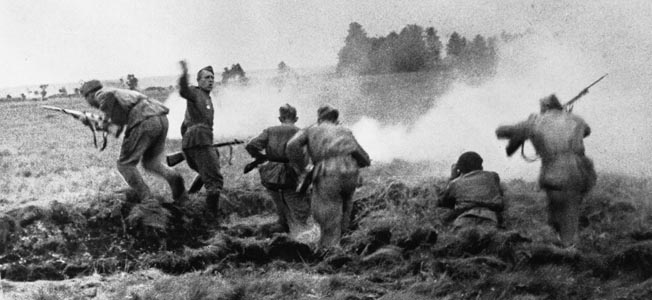 WORLD WAR II: BELORUSSIA.  Soviet infantry charge out of a trench in Belorussia during Operation Bagration. Photograph by W. Suchodolski, August 1944.