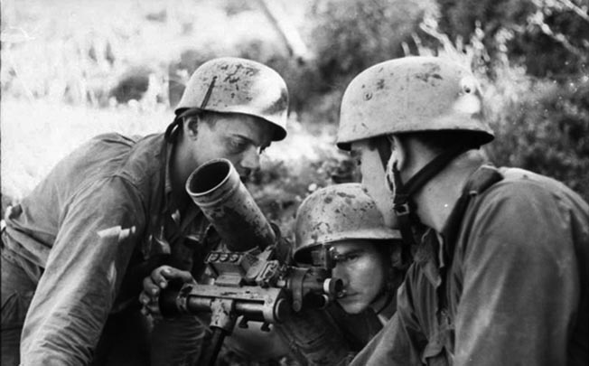 A mortar crew of the outnumbered but tough 1st Fallschirm Division prepares to fire their weapon near Monte Cassino, February 1944.