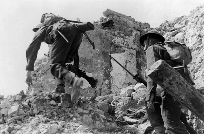 Fighting their way uphill past a shattered building, two New Zealanders attempt to dislodge the enemy. Like all the other units at Monte Cassino, the Kiwis suffered heavy casualties for little gain.