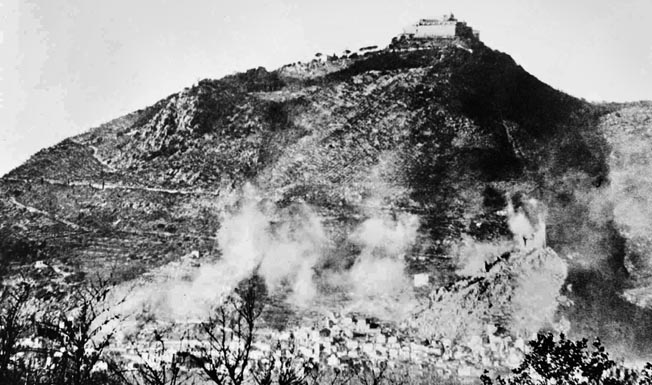 Looming 1,700 feet above Cassino town (shown being shelled by the Allies), the Benedictine abbey offered unrestricted views of the entire area but was not occupied by the Germans until after it was destroyed on February 15.