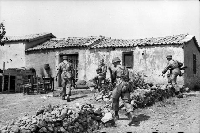 German fallschirmjager converge on a farmhouse somewhere on Crete. Although they took heavy casualties, the Germans captured the island with the help of a British tactical withdrawal from Maleme airfield and key surrounding positions that may have been unnecessary.
