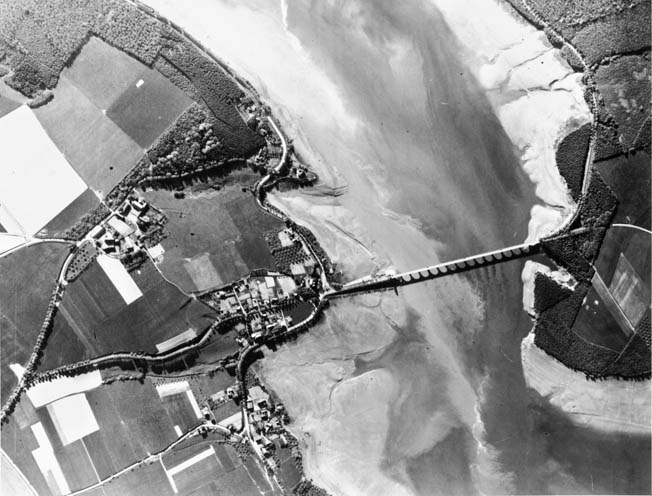 Post-raid RAF reconnaissance photo of the reservoir once held back by the Möhne Dam shows it nearly drained.