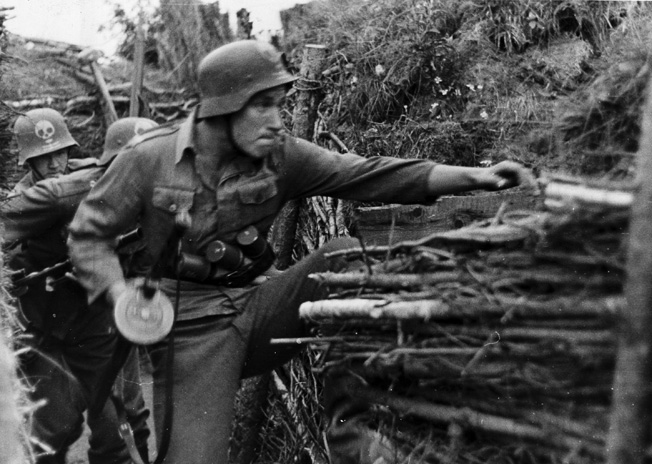 Finnish shock troops take a Soviet position during the Continuation War when Finland was allied with the Nazis, June 1, 1942.
