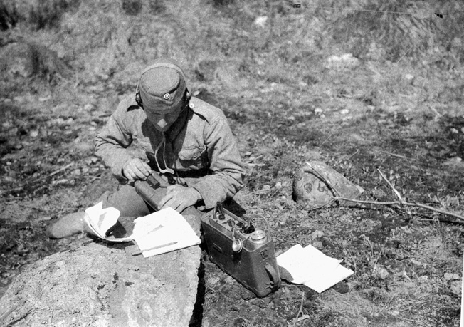 A Finnish radio operator on long-range patrol does his job.