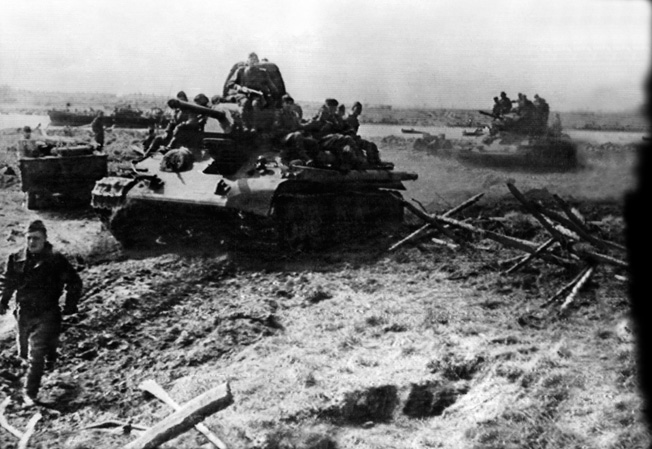 Heavy Red Amy tanks, bearing Russian infantrymen, prepare to annihilate the Finnish defenses in the northern front of the summer offensive.