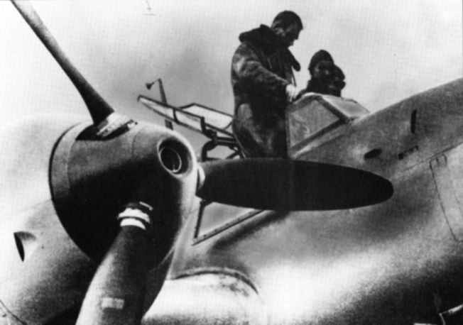 Rudolf Hess stands in the cockpit of the Me-110 he flew to Scotland prior to a test flight.