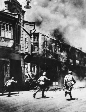 Japanese troops rampage through a burning section of Shanghai, China, January 10, 1937. After the city was occupied, the Bridge House Hotel, converted into a prison by the dreaded Kempeitai secret police, became a place of torture and death.