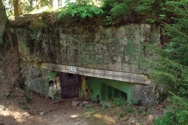 The entrance to a stout German bunker, part of the Siegfried Line, little changed since the fighting in late 1944.