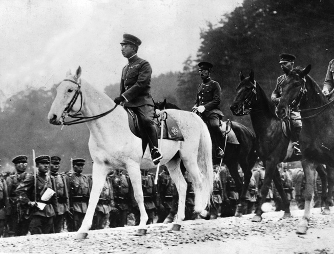 Japanese Emperor Hirohito reviews the troops prior to the outbreak of war.