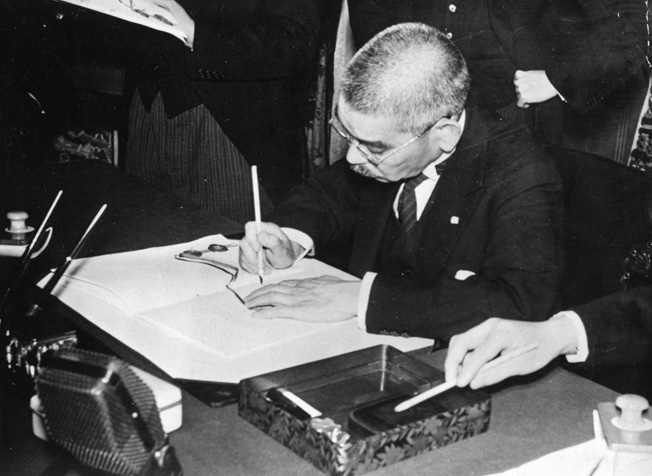 Japanese Foreign Minister Yosuke Matsuoka signs the Japan-French Indo-China economic agreement in Tokyo, May 1941. Matsuoka hated Americans for the racisim he endured while living and studying in Oregon.