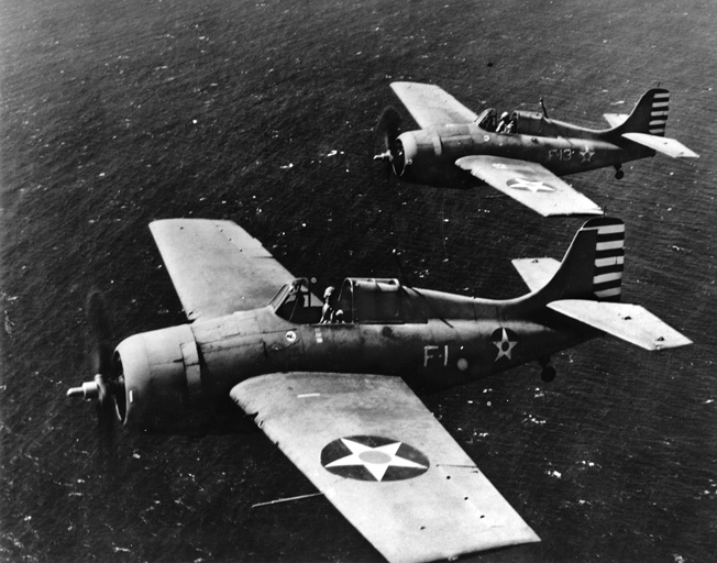 Thach (foreground) and O'Hare flying their Wildcats near Oahu, Hawaii, in April 1942, two months after VF-3's stunning victory.