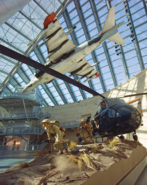 "The Leatherneck Gallery features an AV-8B Harrier ""jump jet"" and a Sikorsky HRS-2 helicopter unloading a machinegun crew during the Korean War."