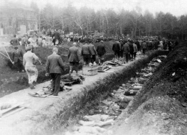 Residents of the town of Nordhausen are forced to view the mass burial of the slave laborers who died at Boelcke Kaserne. Photographed by Dr. Levinson on April 15, 1945.