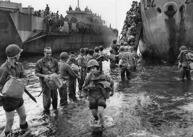 An LSI (Landing Ship, Infantry) discharges a group of nurses onto a beach at Normandy, June 12, 1944, six days after the Operation Overlord invasion.