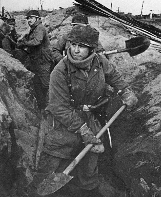 Life wasn't all glamour for elite parachutists. Here Fallschirmjägers dig a defensive position in frozen Soviet soil after the 1941 invasion of the U.S.S.R. Statetzny survived the fighting there, and he and his unit were sent back to Germany for rest, refitting, and more training.