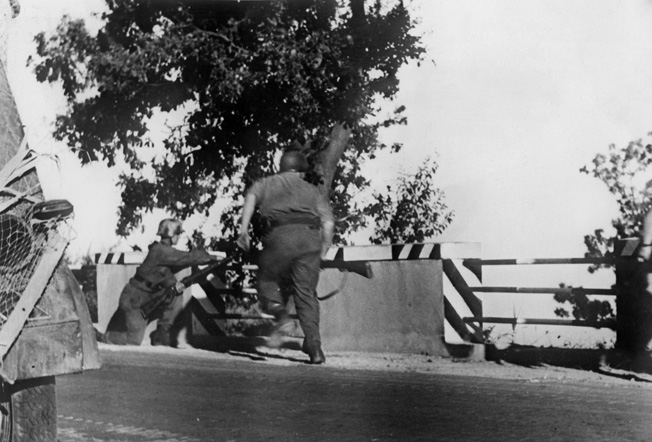 German soldiers set up a roadblock in a vain attempt to contain the American invasion at Salerno.