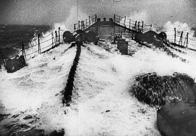 In this image from a German propaganda newsreel, the bow of Scharnhorst is awash in heavy seas in the North Atlantic. Scharnhorst did successfully attack merchant shipping and elements of the British Royal Navy during her short career.