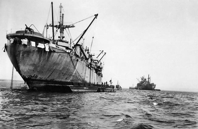 Germans wrecked the port of Cherbourg before the Americans could capture it. While it was being repaired, cargo ships such as these had to be offloaded at sea.